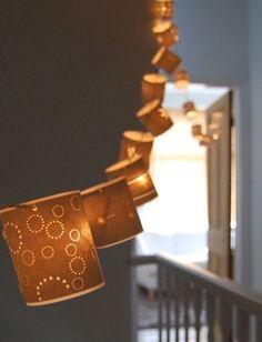 Hannah Nunn Fairy Lights A string of glowing paper cut lanterns 5 M long, each lantern 7 cm high Photographer: Hannah Nunn :: from the book illuminate contemporary craft lighting by hannah nunn. Diy Luz, Light Crafts, Glow Crafts, Ideas Geniales, Paper Lanterns, Paper Lamps, Light Decorations, Fairy Lights, Paper Cutting