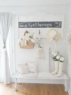 Whitewashed shabby chic entryway with netural textiles and a chalkboard.
