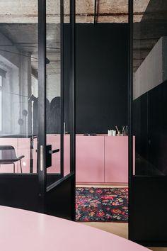black walls flower carpet with pink furniture