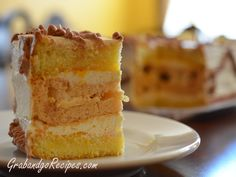 Kiev Cake  layers of very dense meringues between extremely rich butter cream and layers of soft sponge cake. The whole thing is spongy, creamy, buttery and crunchy at the same time!!