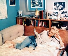 Marylin at home - jeans and a button down always work. (Also, like the matched matting to adjacent wall color.)