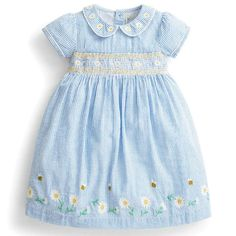 If you're looking for a pretty piece that's light and airy for warm summer days, choose our Girls' Blue Stripe Daisy Smocked Dress. Traditional style smocking features around the waist, while the sweet floral embroidery to the hem and Peter Pan collar ens Toddler Girl Style, Toddler Fashion, Toddler Dress, Girl Fashion, Spring Fashion, Expensive Clothes, Tulip Dress, Blue Stripes, Smocking