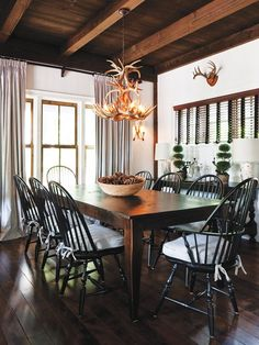 black windsor chairs with dark wood table. Gorgeous windows too ...