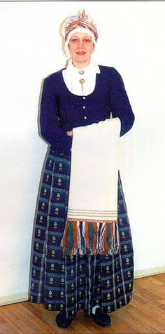 Zemgale or Semigallian Costume, Latvia. This woman is wearing a skirt with a design known from Gluda and Zalenieki. The plaid with floating woven design is reminiscnent of those in Dzukia, in Southeastern Lithuania.