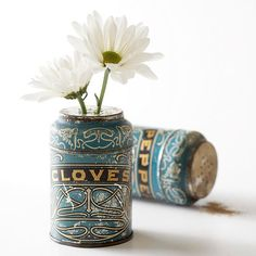 Old seasoning bottles make perfect holders for flower stems! More flea market chic home accents: http://www.bhg.com/decorating/decorating-style/flea-market/flea-market-chic-home-accents/?socsrc=bhgpin081913seasoningbottles=27