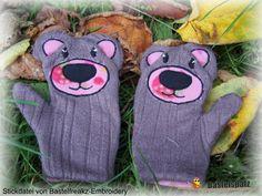 Ein Paar Handschuhe nach der Stickvorlage von Bastelfreakz-Embroidery