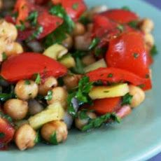 Tomato and Garbanzo Salad. 1 can garbanzo beans (chickpeas drained well) 2 tbsps balsamic vinegar 3 cups diced tomatoes 1/2 cup sweet onion (diced, or red onion) 1 yellow bell pepper (large, diced) 1 cup chopped parsley (or more finely) ground black pepper (salt, fresh, to taste) salt (fresh ground black pepper to taste) 3 tbsps extra virgin olive oil 1 tbsp fresh lemon juice