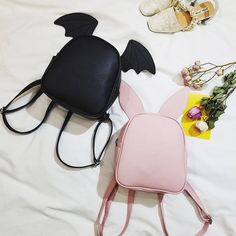 """There are three pairs of ears. Color:pink,grey,black,dark green, Size: Height:24cm/9.36"""". Width:20cm/7.80"""". Thick:11cm/4.29"""". Fabric material:pu. Tips: *Please double check above size and consider you"""
