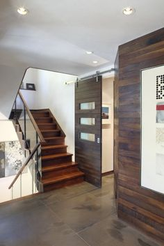 Wood wall treatment. Stikwood burnt umber oak can deliver this style to your front door.