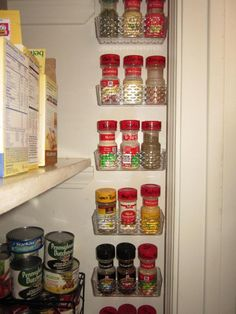 Hold small things to wall in the kitchen. You can pull down the entire bin if you need to.