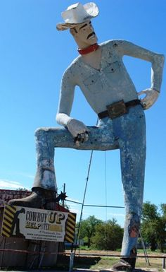 Tex Randall, World's Largest Cowboy - Canyon, Texas on United States Route 60;   stands 47 feet tall;  installed in 1959, and restored in 1989