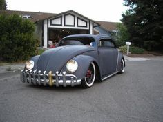 Hot Rod style Beetle with 60's Gold Tooth Grille/Bumper. So cool.