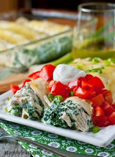 Skinny Creamy Chicken Enchiladas - Delicious and low-calorie, these enchiladas are a complete meal that is quick and easy to make!
