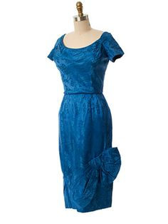 Authentic 50s cocktail dress in sapphire blue floral silk damask.  Flattering draped neckline and draped flounce on pencil skirt.  #bluevelvetvintage
