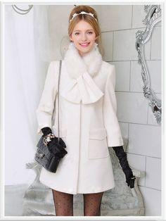 Morpheus Boutique  - White Bow Wool Long Sleeve Ruffle Coat, CA$194.85 (http://www.morpheusboutique.com/white-bow-wool-long-sleeve-ruffle-coat/)