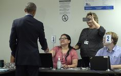 ... in with poll workers to cast his ballot at the Chicago Board of Elections in the Cook County Office Building in Chicago, Friday, Oct. 7, 2016. Obama is ...