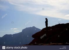 Silhouette Of A Woman On Top Of A Sandstone Cliff With Mountains In Stock Photo, Royalty Free Image: 41979653 - Alamy
