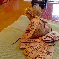 Mi'kmaw Birch bark Christmas gift tags. Wood burning designs; water colour pencils for extra touch up.