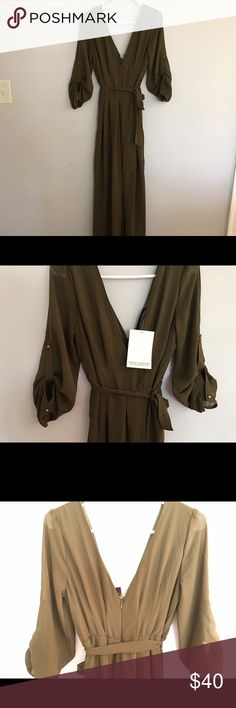 Green boutique jumpsuit size medium NWT Green boutique jumpsuit size medium NWT Dresses