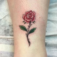 Fine line rose tattoo