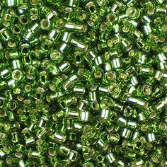 Miyuki 11/0 (1.6mm) Delica Silver-Lined Olive glass cylinder beads, colour number DB 1207, transparent fern green, shiny inside. UK seller.