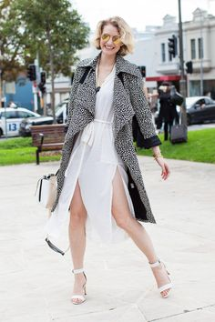 14 Street-Style Snaps From Down Under #refinery29  http://www.refinery29.com/australian-fashion-week-pictures#slide14  We'd do a happy dance, too, in this pretty, chiffon number and offbeat trench.Similar finds:
