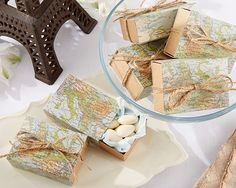 Map Travel Themed Sliding Favor Boxes (Set of 24) (Kate Aspen 28185NA) | Buy at Wedding Favors Unlimited (http://www.weddingfavorsunlimited.com/map_themed_sliding_favor_boxes_set_of_24.html).