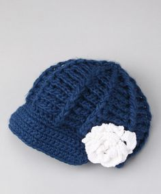 Crochet newsboy hat with white flower.