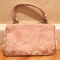 100% Silk Banana Republic Clutch Gorgeous pink 100% silk purse with beige floral pattern. Has a small hand strap and inside pocket for cards/ cash. Can fit an iPhone 6S and still have room for makeup! Hardware is gold tone. Latch closure. Excellent condition. No stains. Used once. Banana Republic Bags Clutches & Wristlets
