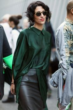 Haider ackerman type of dressing up a leather skirt with a green silk blouse