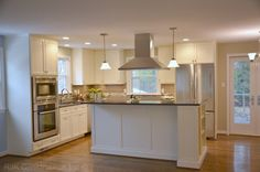 two level kitchen island with stovetop | White Cabinetry Kitchen with Island traditional kitchen