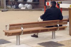 A view of the Scroll seat. It's ribbed construction and rolled edges provide robust street seating for a range of environments. The Scroll seat (with armrests) is based on the standard Scroll seat. http://factoryfurniture.co.uk/index/products/seating/scroll-range/scroll-seat-with-armrests.html