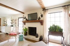 Magnificent Interior with Fireplace Mantel Shelf under Flat TV on Wood Board Rack add with Armchair on Floor