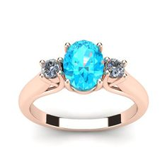 1/2 Carat Oval Shape Aquamarine and Two Diamond Ring In 14 Karat Rose Gold