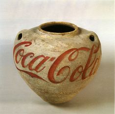 Ai Weiwei Neolithic vase (5000-3000 BC) with the Coca-Cola logo painted.