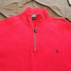 Polo Men's Quarter Zip Red Sweater Polo Ralph Lauren Men's 1/4 Zip Red Sweater. Some minimal fading from wear. EUC- priced accordingly. Polo by Ralph Lauren Sweaters