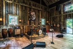 This barn by Kelly and Co. Design is no ordinary barn. Professional soundproofing and a stage make this a perfect place for musical performances, while a kitchen/bar and sleep quarters stand at the ready for overnight guests.