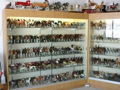 Karen Grimm's Model Horse Collection.....over 7000, in a wing of her house dedicated to them.  Go to her site, the photos  are mind-boggling!   This photo is only a SMALL part of it.