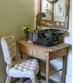 A vintage typewriter, a small desk, and botanical prints displayed in a weathered window frame make for a cozy and inspiring corner. RELATED: 26 Design Ideas for Home Offices