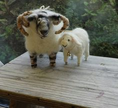 Ewe and me. Ooak(one of a kind)needle felted ram and sheep. This adorable pair are felted with a single needle using ethically sourced merino sheeps wool,he has elements of Tawney browns and black,she is White with touches of and pink . The couple wear matching silver bells and have seed bead eyes Size ram night 12 cm . length 12 cm. Ewe, height 7 cm length 9 cm  These soft sculpture sheep would make a wonderful cake topper,couple gift or a sweet reminder of how its the smallest things that…