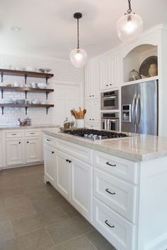 Kitchen Remodel - Open shelving, subway tile wall, new island and frig wall cabinetry