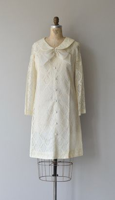 Vintage 1960s white diamond lace dress with wide peter pan collar, white organza bow, false button front, long lace sleeves, slight a-line shape, full