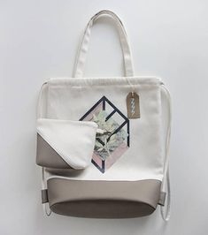 Tote bag / shoulder bag / backpack /drawstring bag + makeup bag, case. Canvas bag with a beautiful abstract graphic on the front. The wide base creates an elegant shape, and makes it perfect for everyday use as well as a shopping bag, school backpack or to carry documents, the wallet