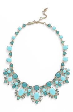Adding a glamorous touch to any ensemble with this turquoise statement necklace for a pop of color.