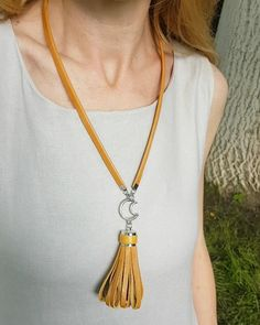 """Long statement tassel necklace, in camel brown leather.  This necklace is a very unique statement necklace, made with the warmest shade of honey camel brown. The necklace is 100% handmade with top quality Italian cow leather, super soft and has a satin finish. The long tassel has a cute moon charm at the top and it hangs from a handmade leather cord. I added a 2"""" chain and lobster clasp to be able to wear it shorter or longer. Leather Tassel, Leather Necklace, Cow Leather, Leather Cord, Diy Jewelry Necklace, Tassel Necklace, Jewellery, Leather Jewelry Making, Moon Charm"""