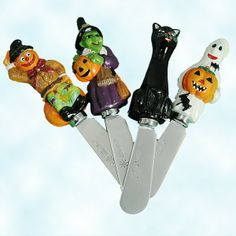 "Halloween and Fall Spreader set of 4 by Christopher Radko. (99-660-0, 996600) Created in 1999 for the Home for the Holidays collection, each blade is engraved with the usual ""RADKO""; 1) scarecrow; 2) green witch holding jack-o-lantern; 3) black cat; 4) ghost holding jack-o-lantern."