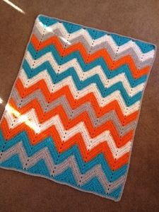 Orange blue (teal) chevron baby blanket (throw). No pattern but very easy. Really like the colors. Perfect for my Gator family