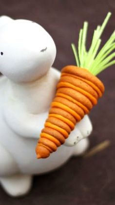 3-D Stacked Carrot Cookie ~ Here's a tasty treat for your Easter table. Any bunny would have fun creating these simple, stacked carrot cookies, complete with edible green tops!