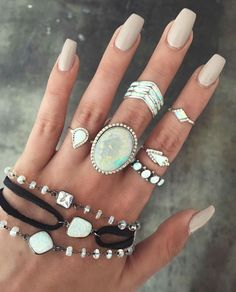 Neutral nails with lots of rings