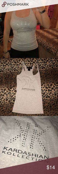 Kardashian Kollection racer back tank top The Kardashian's kollection was a line ran by the famous sisters in stores such as sears. This is a vintage racer back tank that's comfortable. Worn twice, in great condition Kardashian Kollection Tops Camisoles